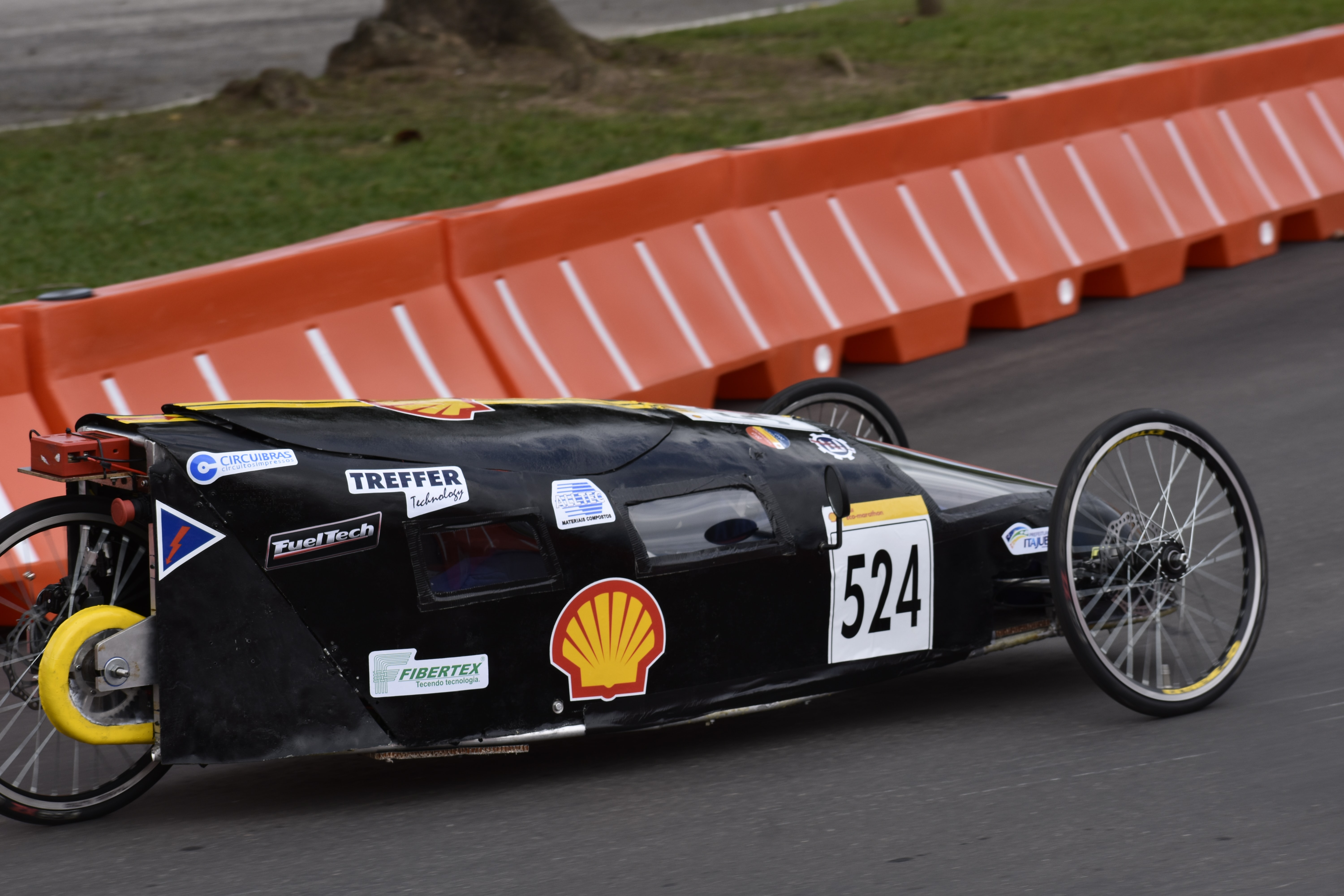 black racing car on track during day time