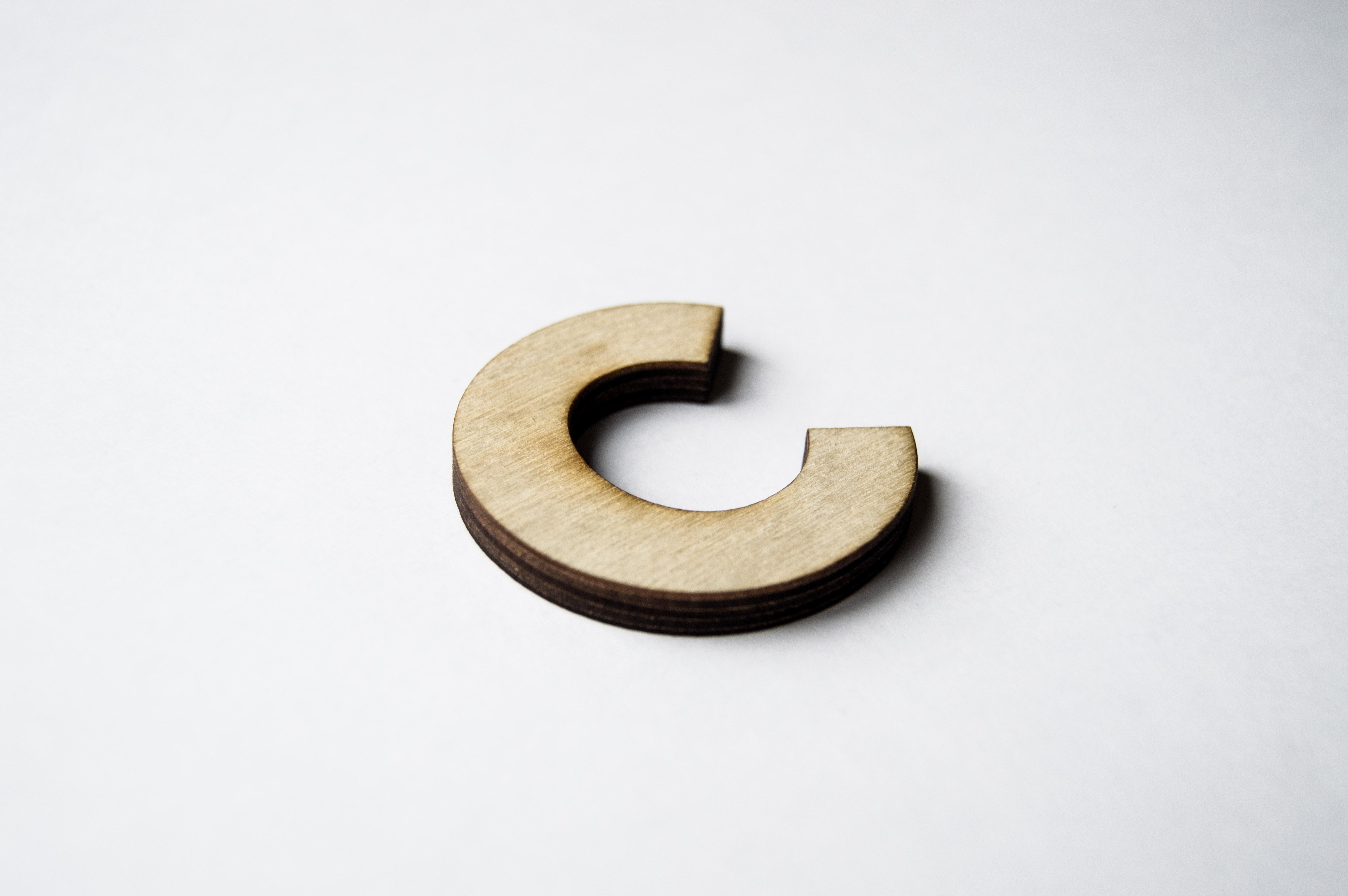 brown wooden letter c decor