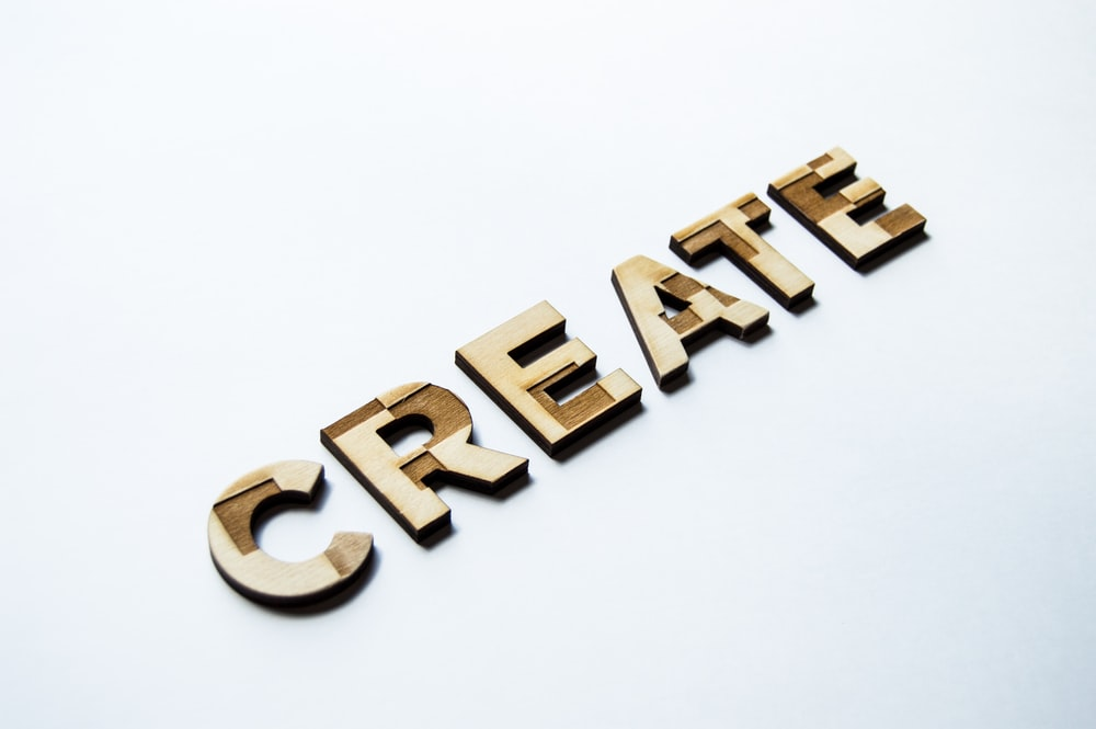 word tiles that spell: create.