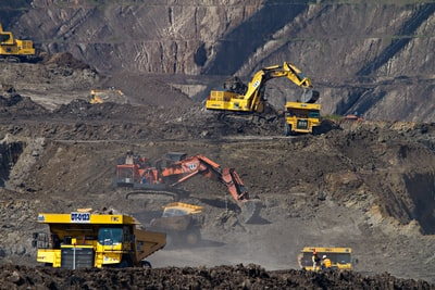 photography of excavators at mining area coal teams background