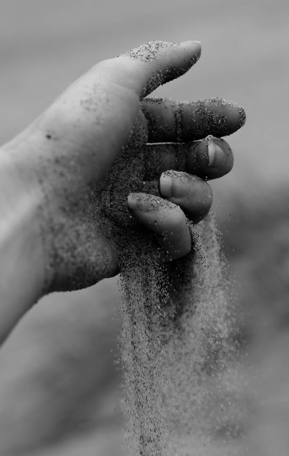 grayscale photo of person palm