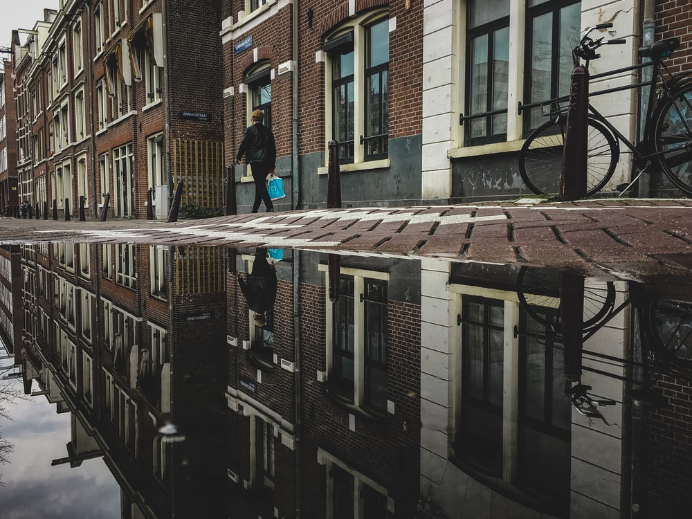 person walking on brick pavement