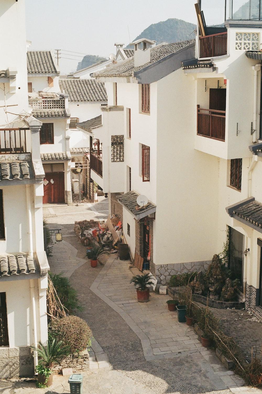 white concrete houses near mountain