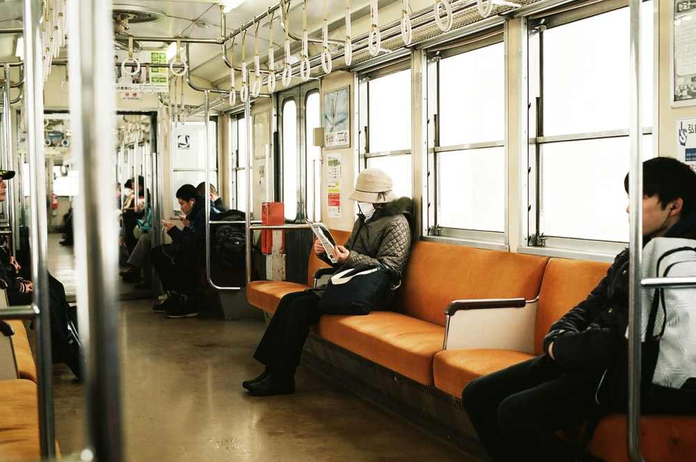 man sitting inside the train