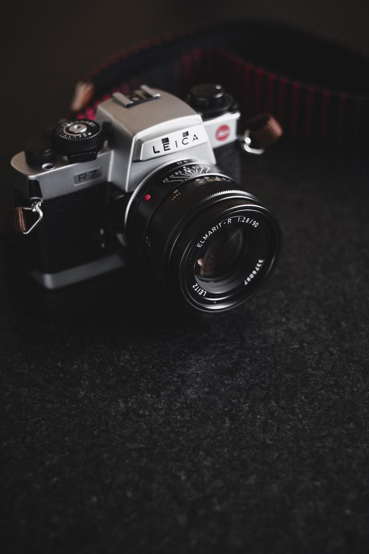gray and black Leica film camera on carpet