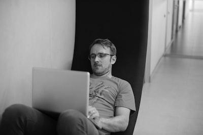 man using laptop inside room