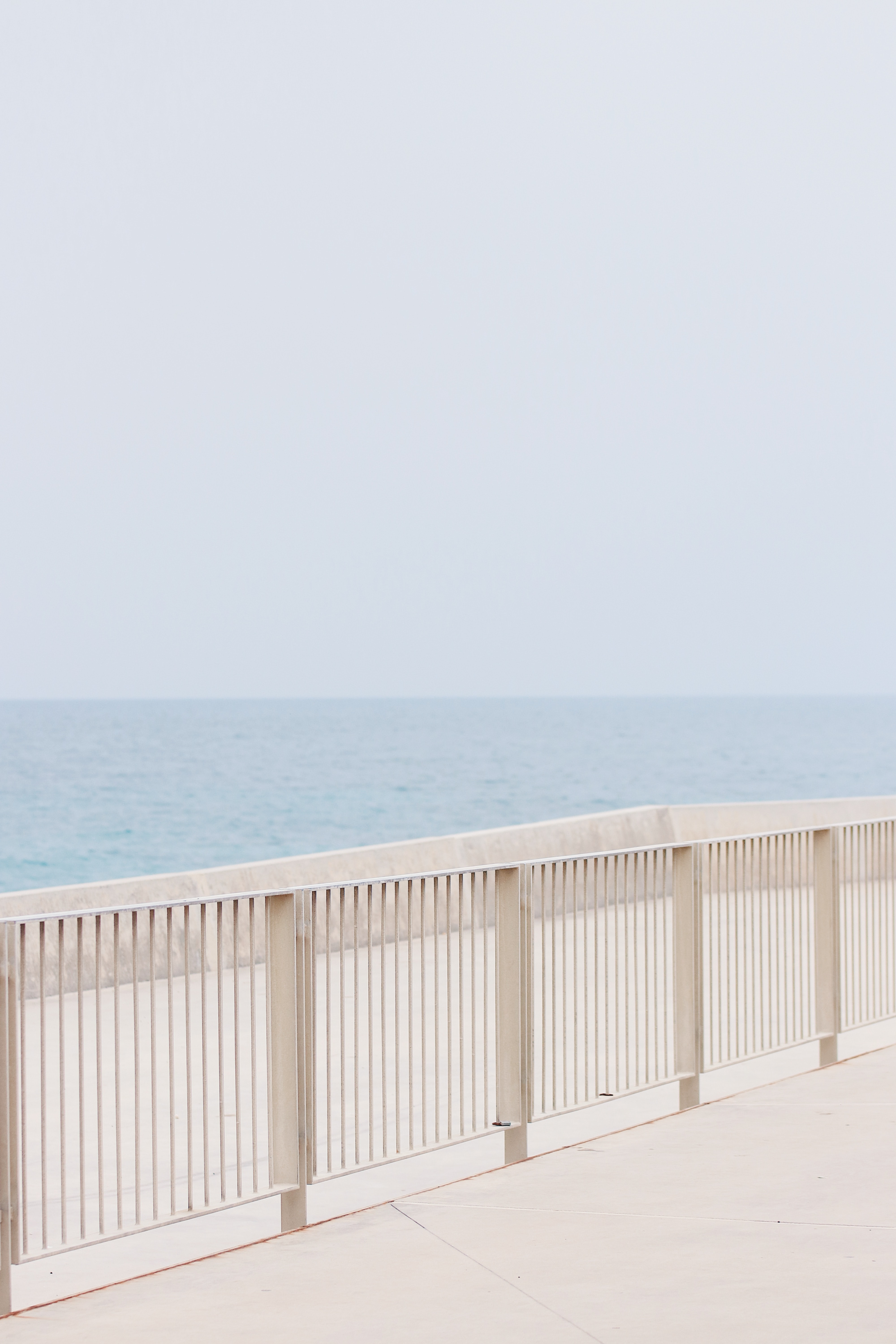 white metal handrails in a distance of sea