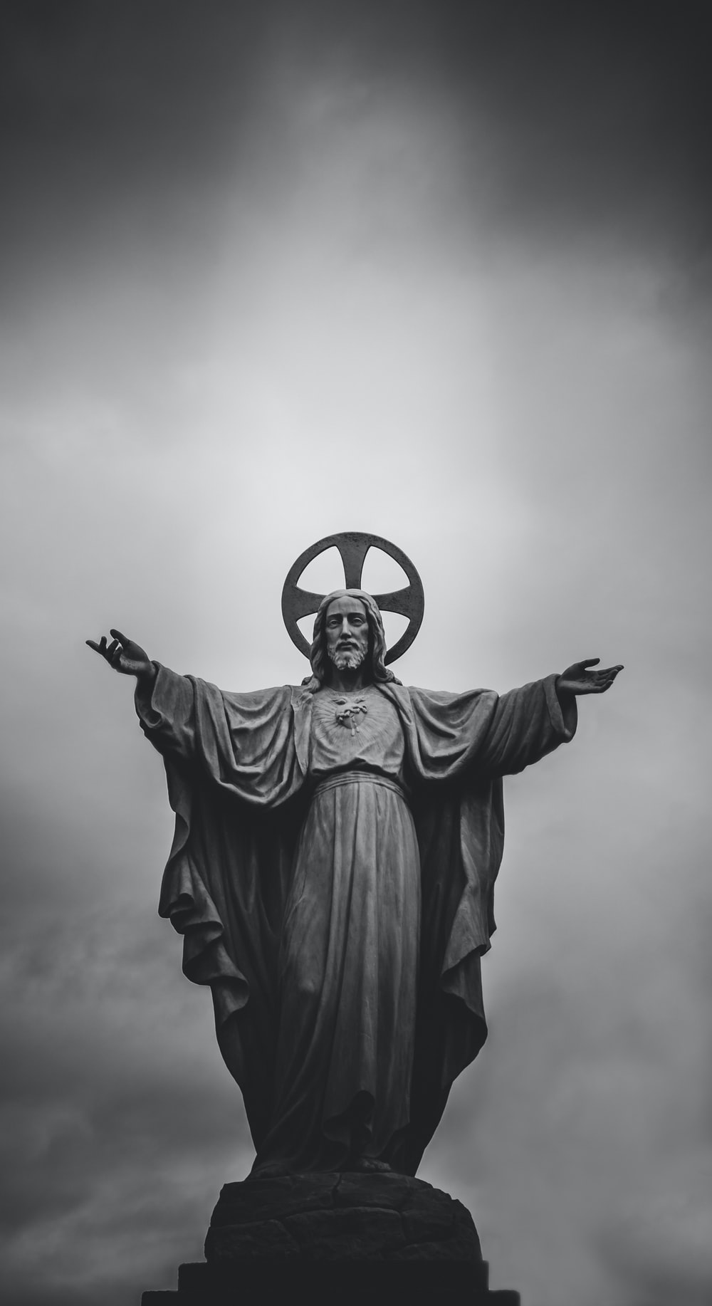grayscale photograph of Jesus Christ statue