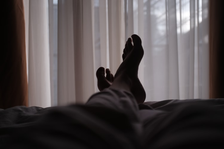 patient resting in hospital bed after rehab
