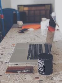 laptop beside mug