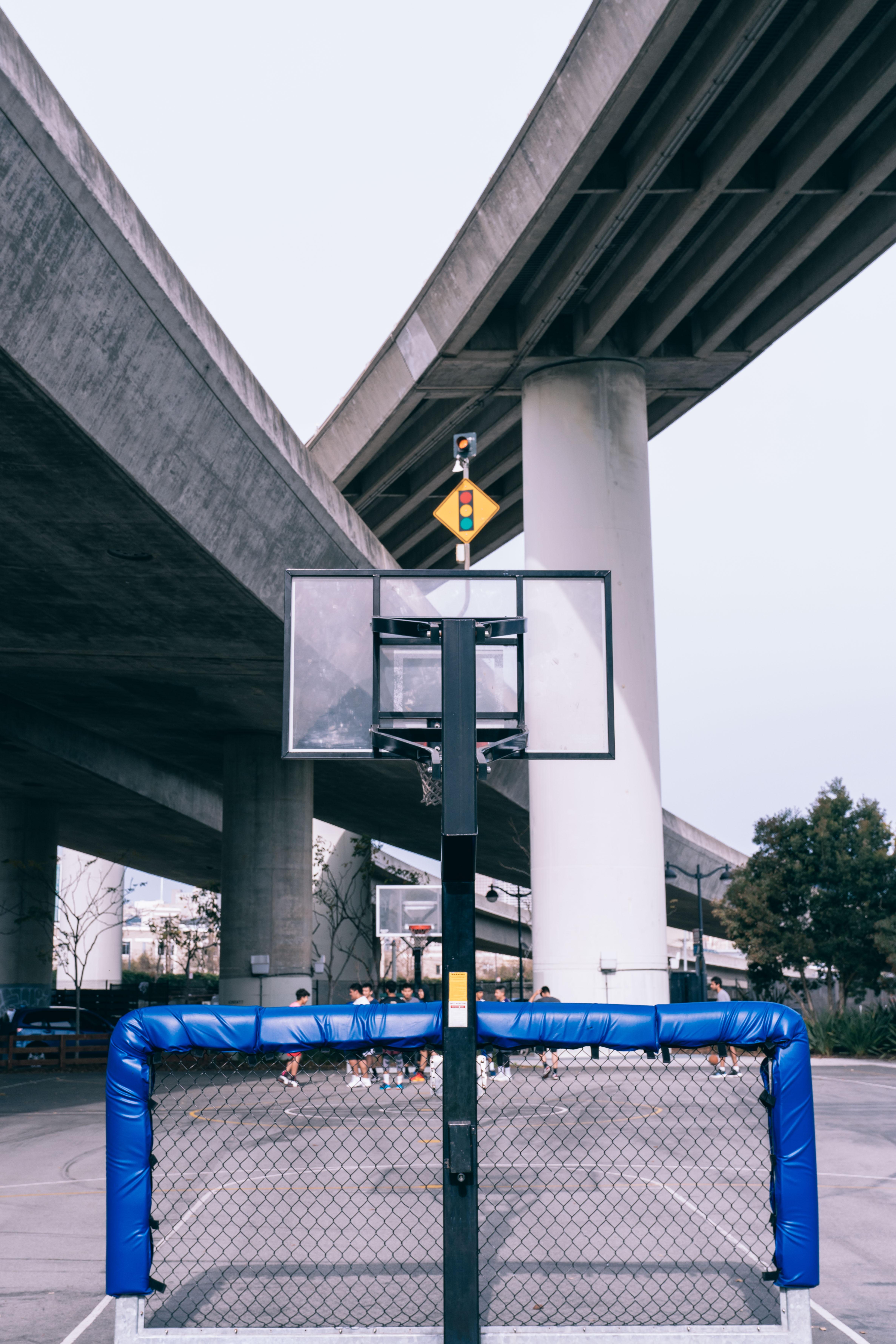 photo of soccer goalie below basketball system