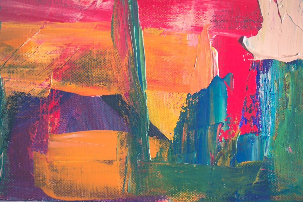 green, yellow, and red abstract painting
