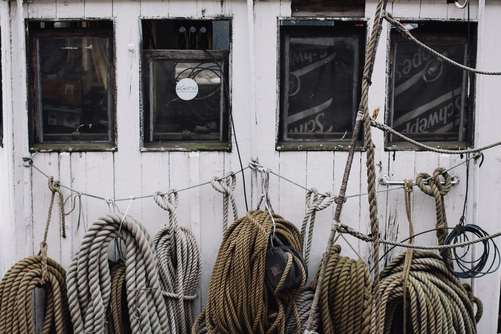 brown ropes hanging on strings