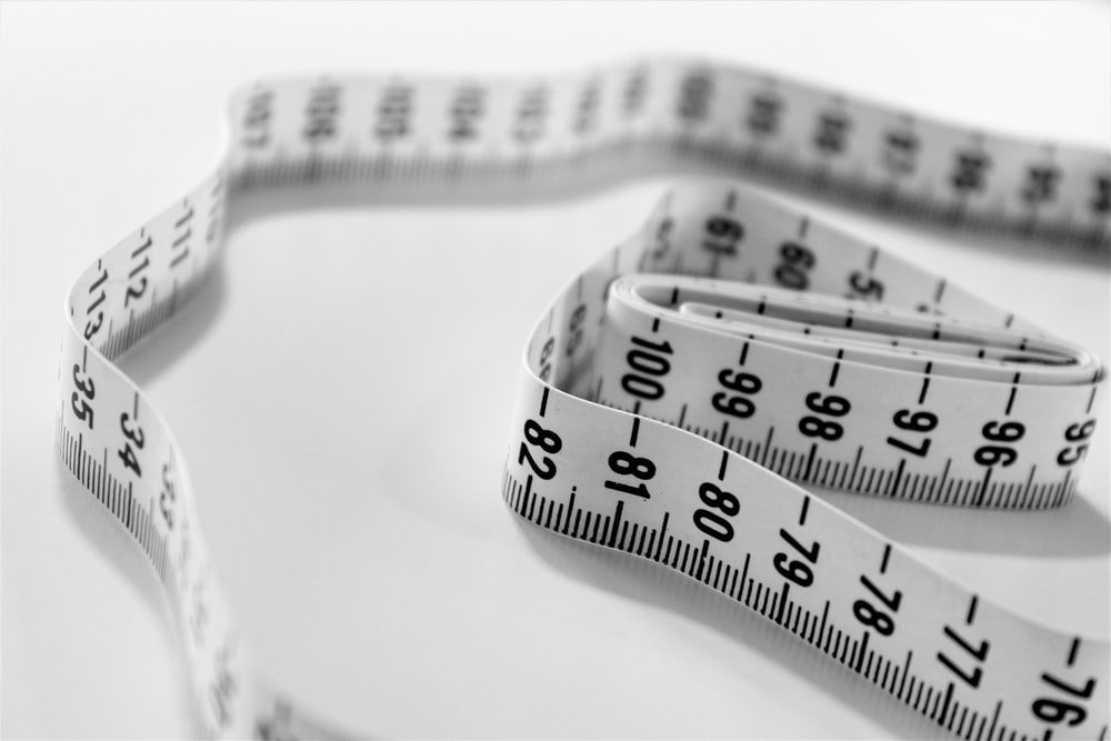 selective focus photography of tape measure