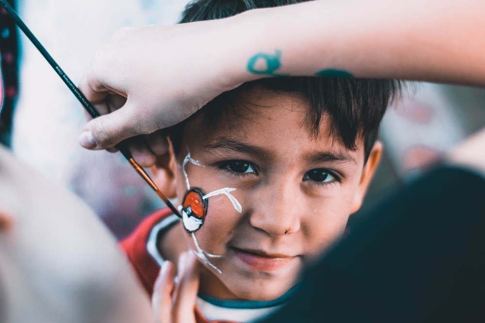 boy drawn Pokeball on his face