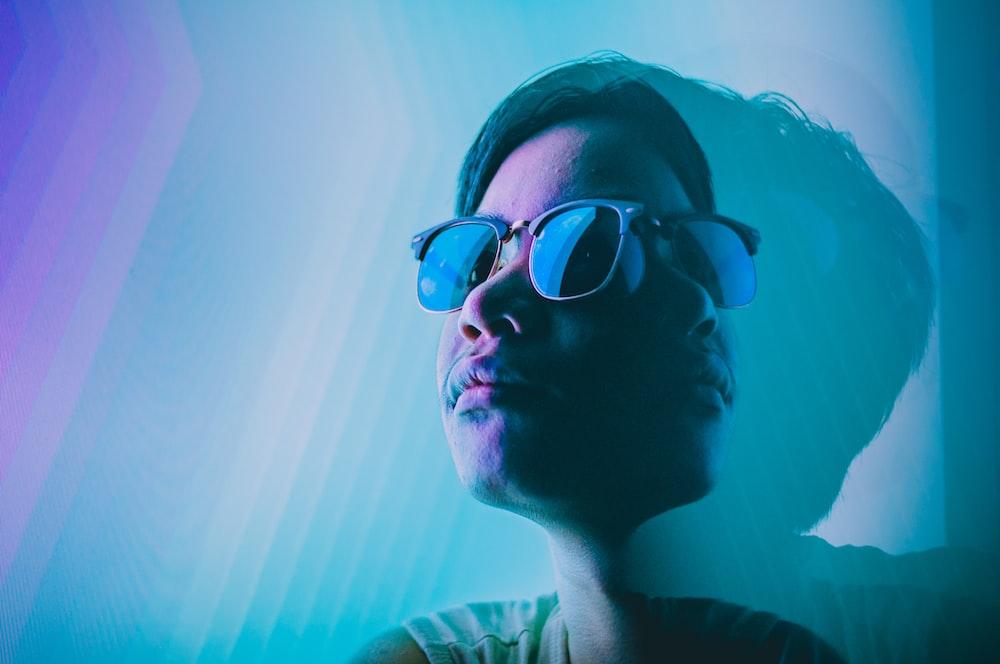 man wearing black framed Clubmaster-style sunglasses digital wallpaper