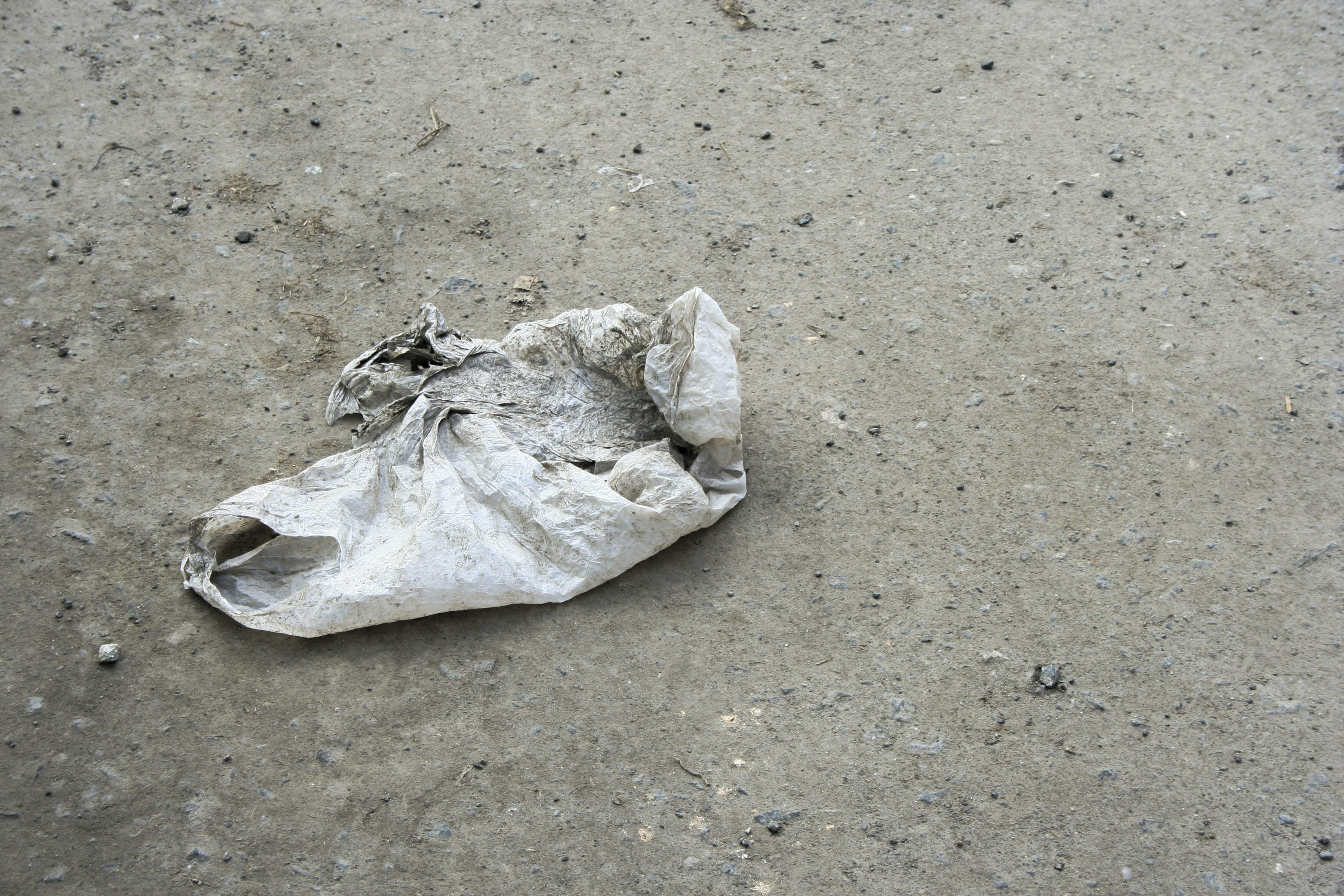 white plastic bag on gray surface