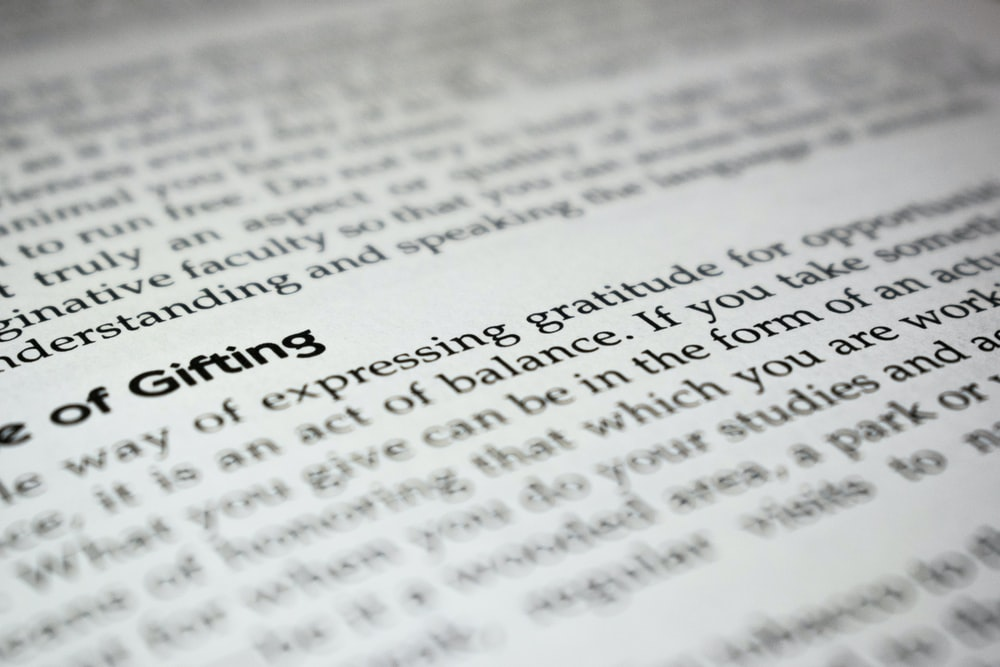 selective focus photography on a printed paper
