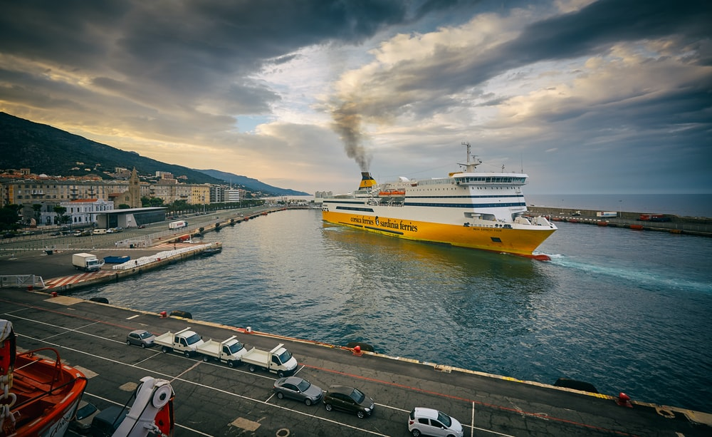white and yellow cruise ship on deck