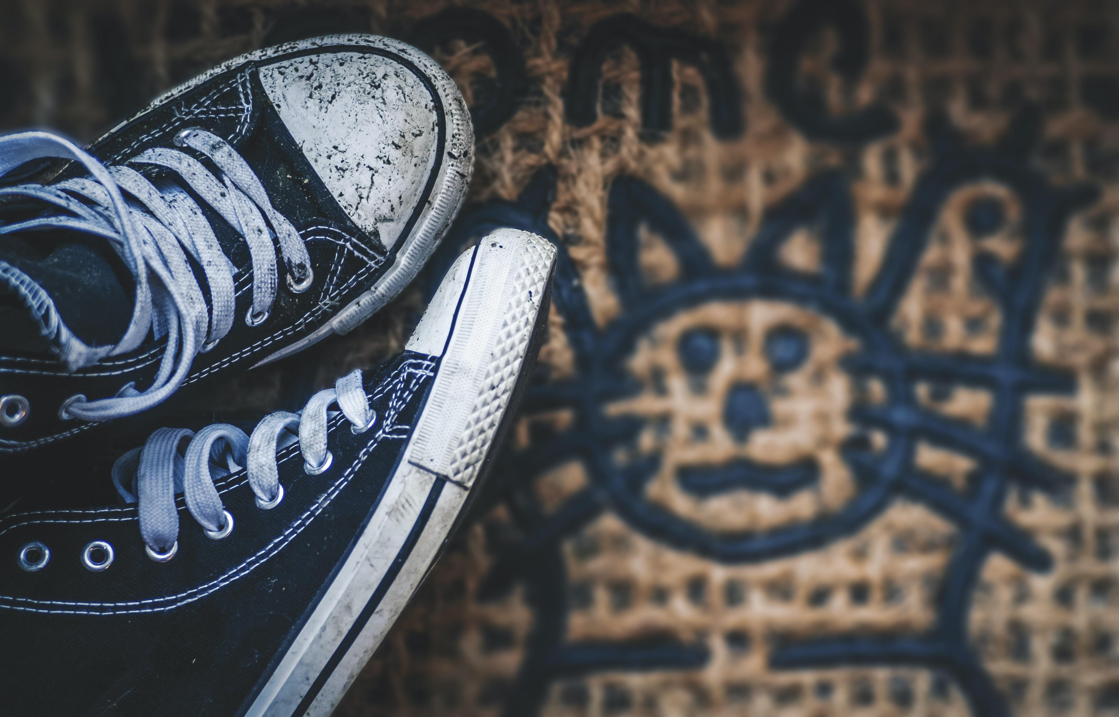 close view of pair of black sneakers