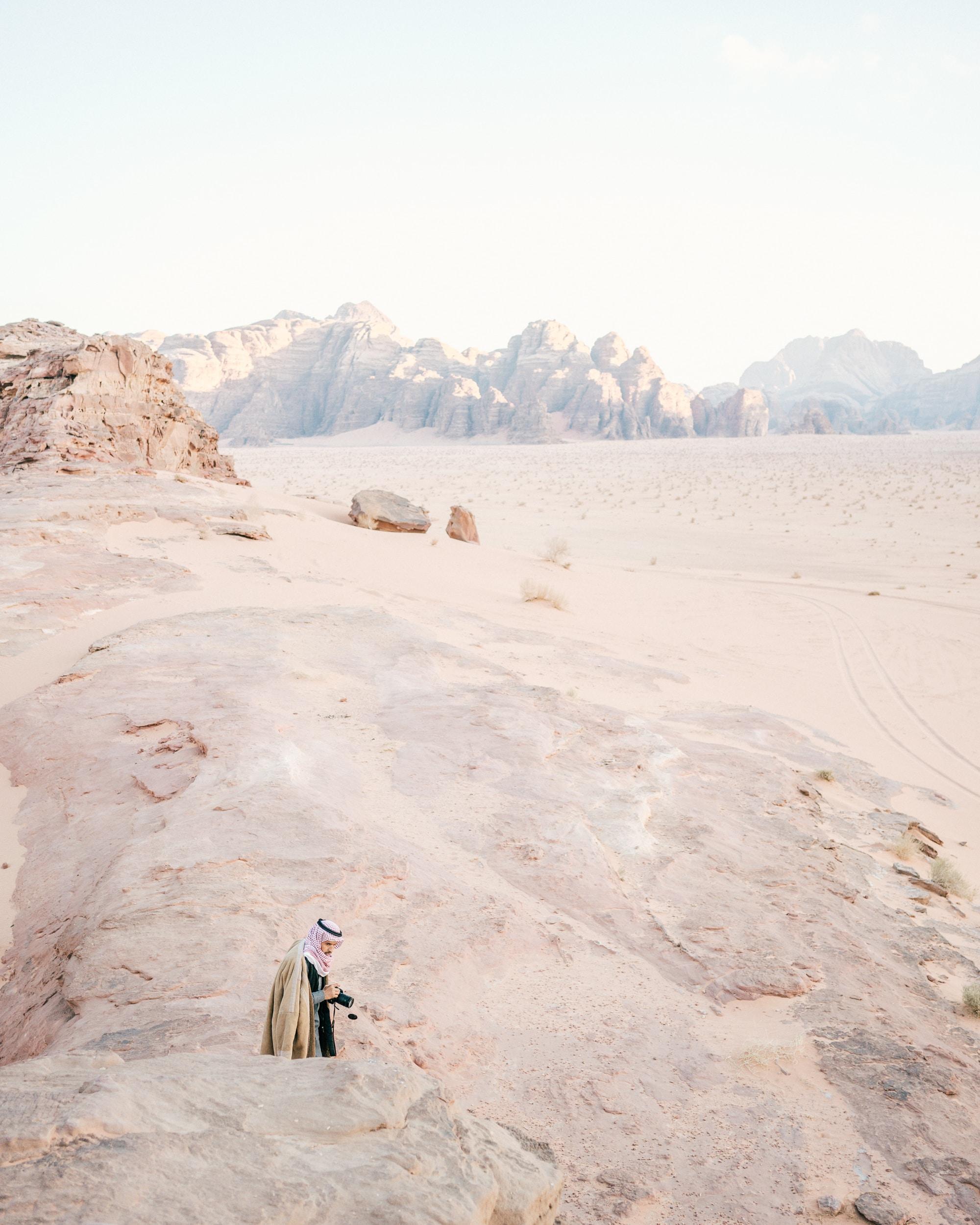 person standing on white sand desert