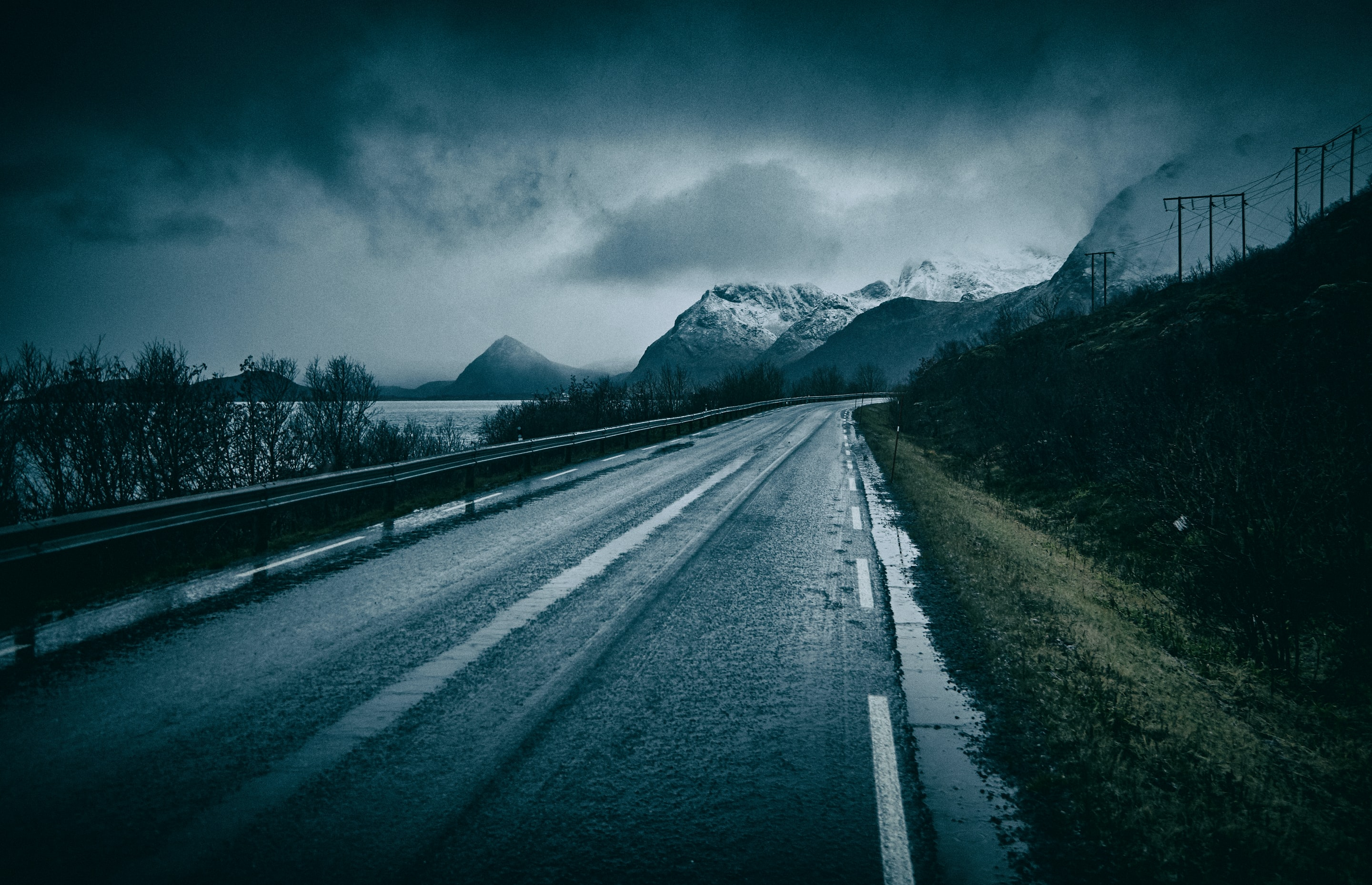 photography of empty roadway near glacier mountains at daytime