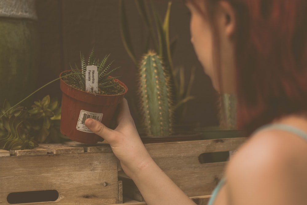 woman holding plant pot