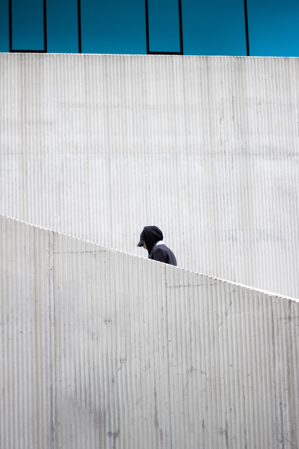 person in black cap and hoodie