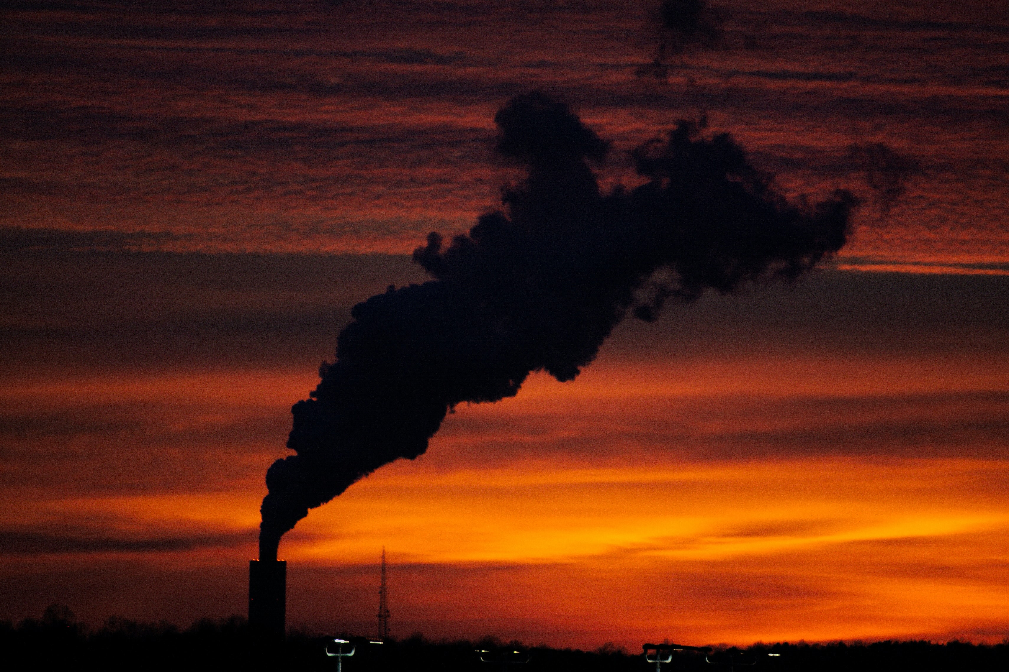 silhouette of factory smoke