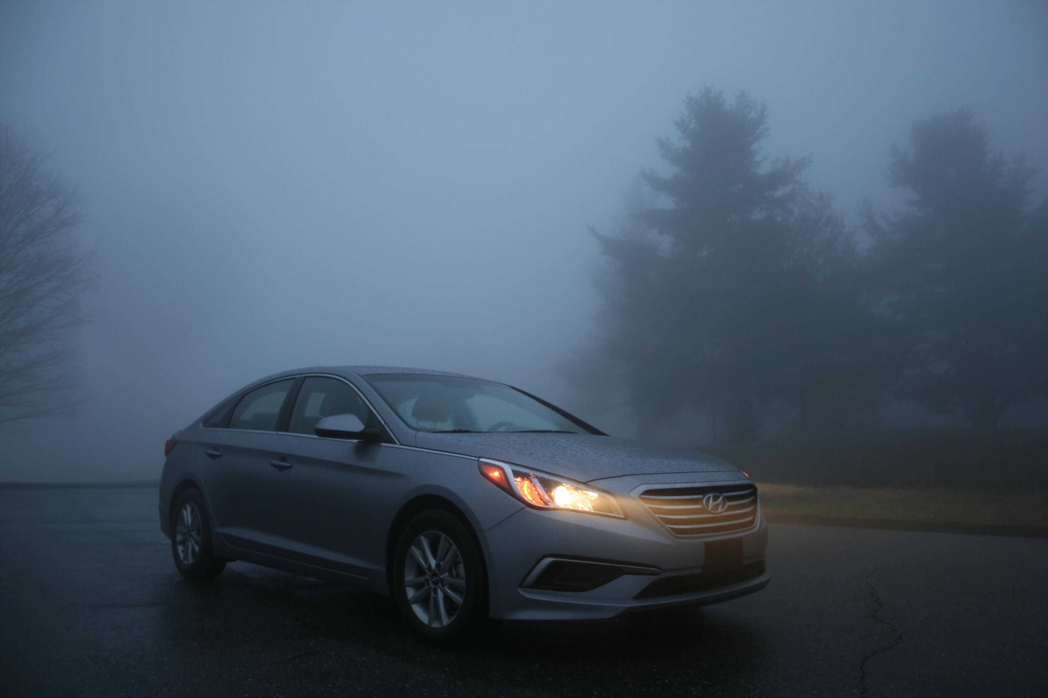 silver Hyundai sedan on gray concrete road