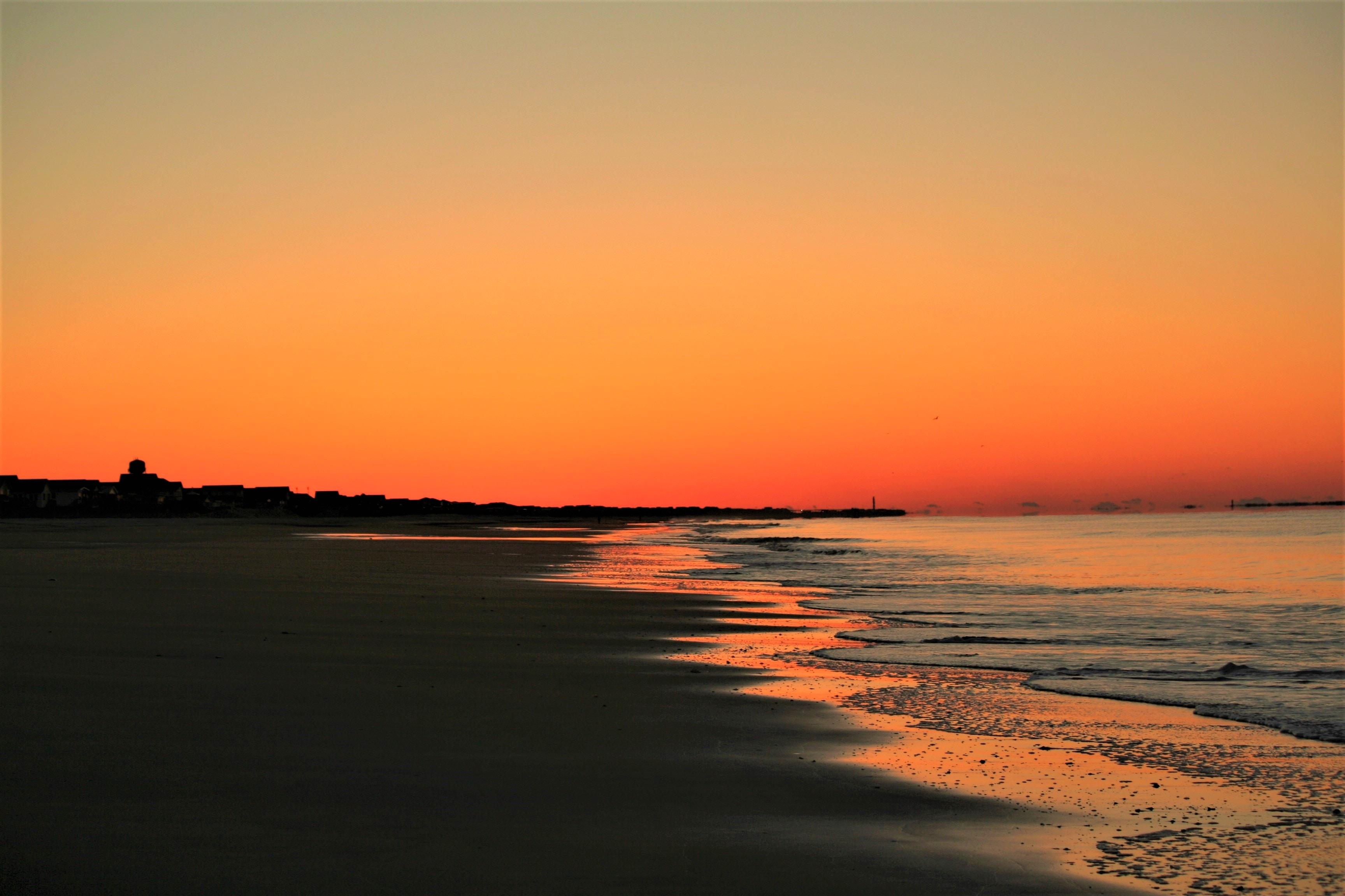 photo of shoreline during golden hour
