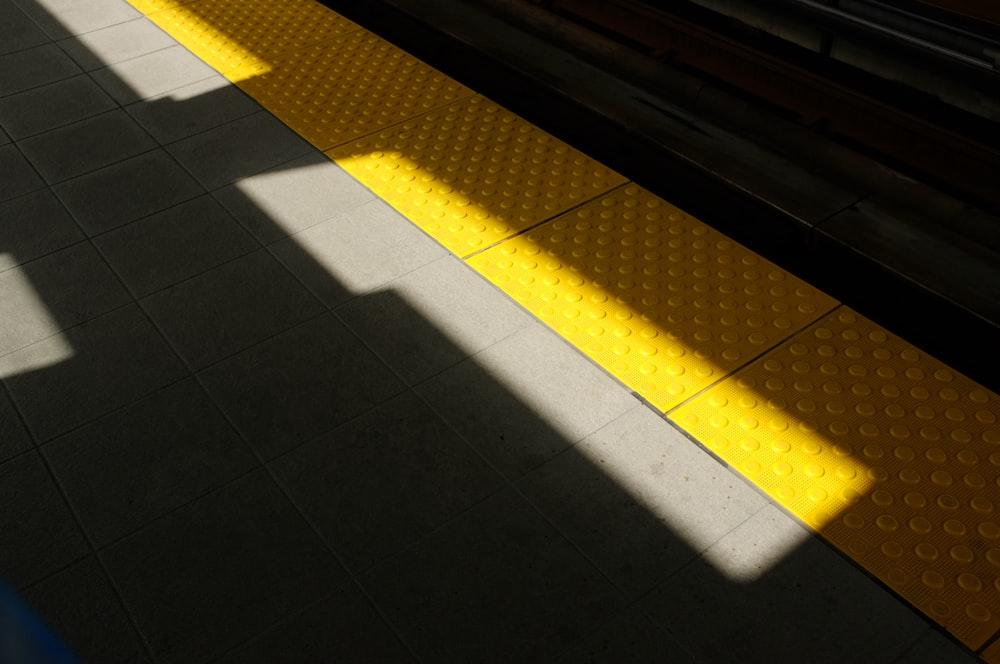 yellow mat on pathway