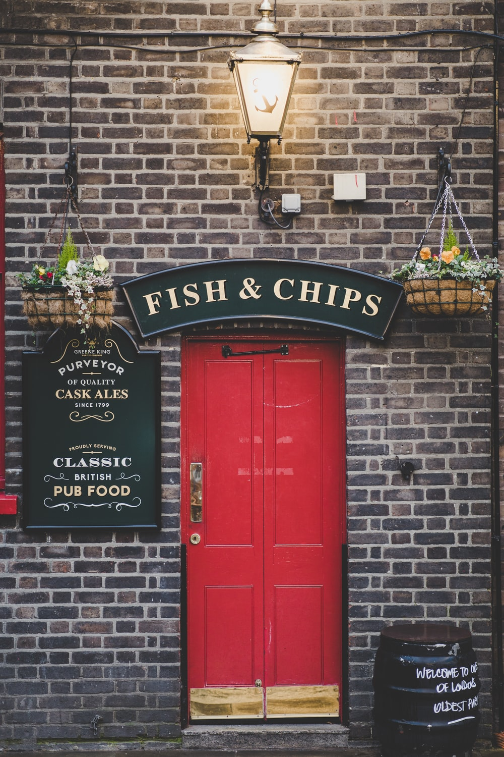 Fish & Chips signage over red door