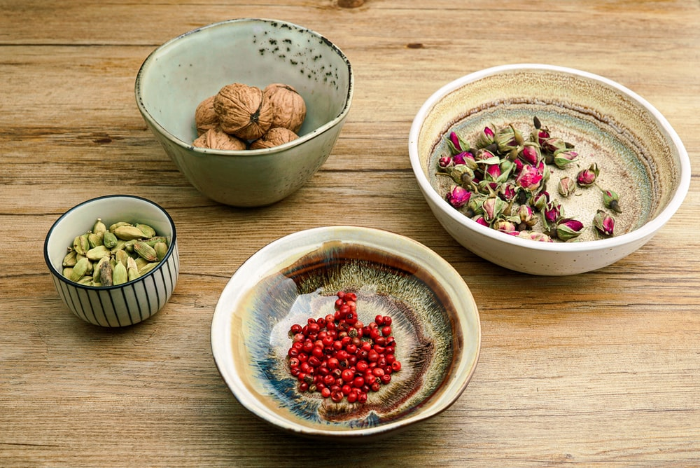 four assorted ingredients on bowls