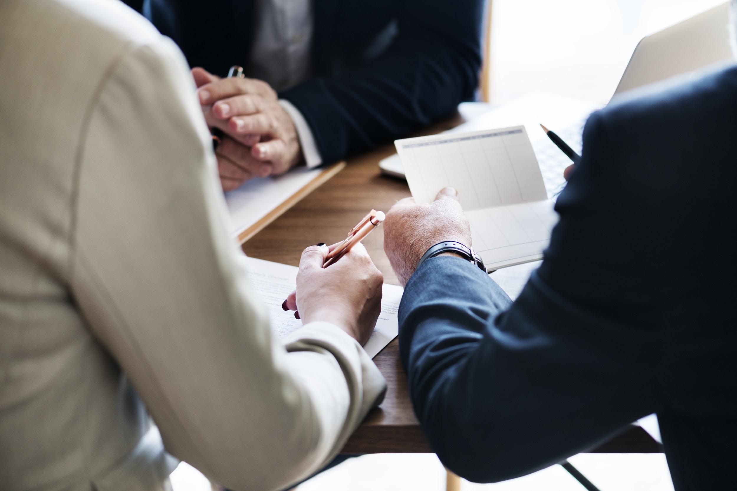 Three individuals having a meeting