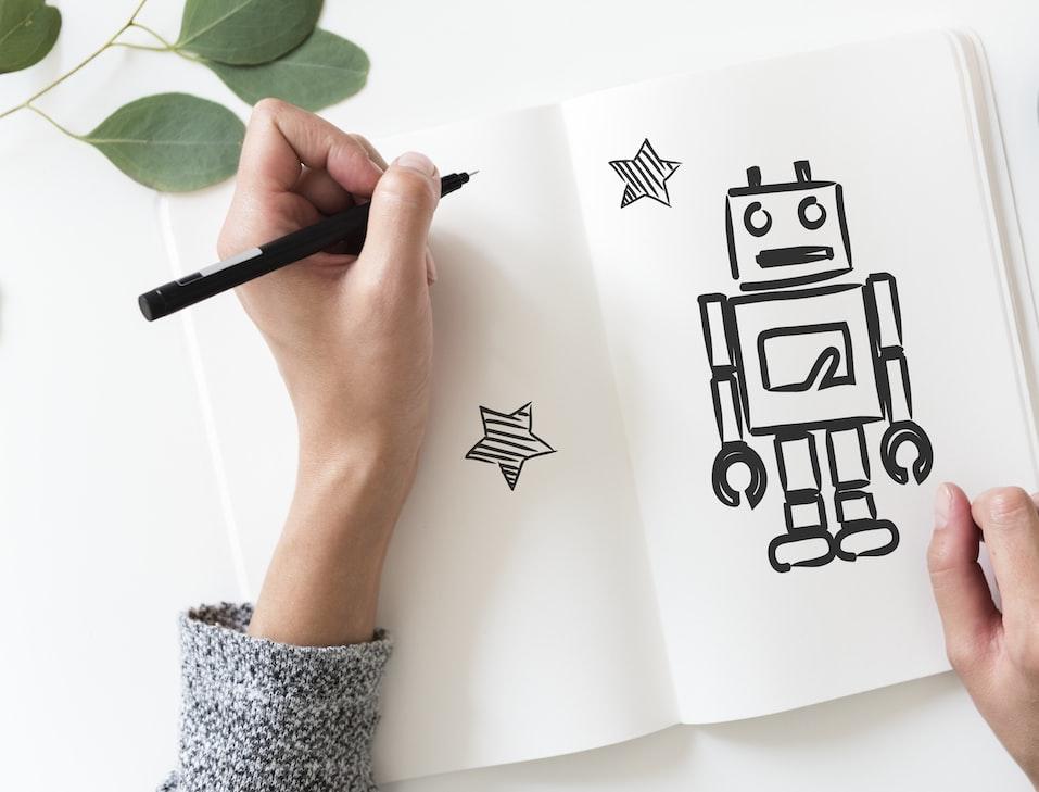 Artist drawing a robot