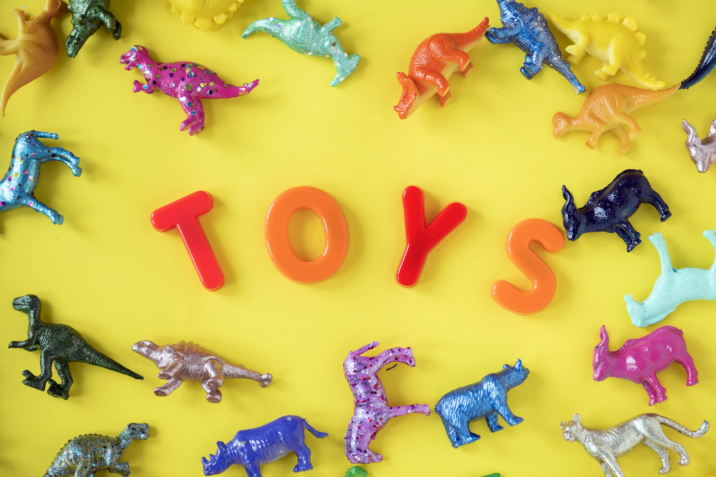 a lot of animal and dinosaur toys
