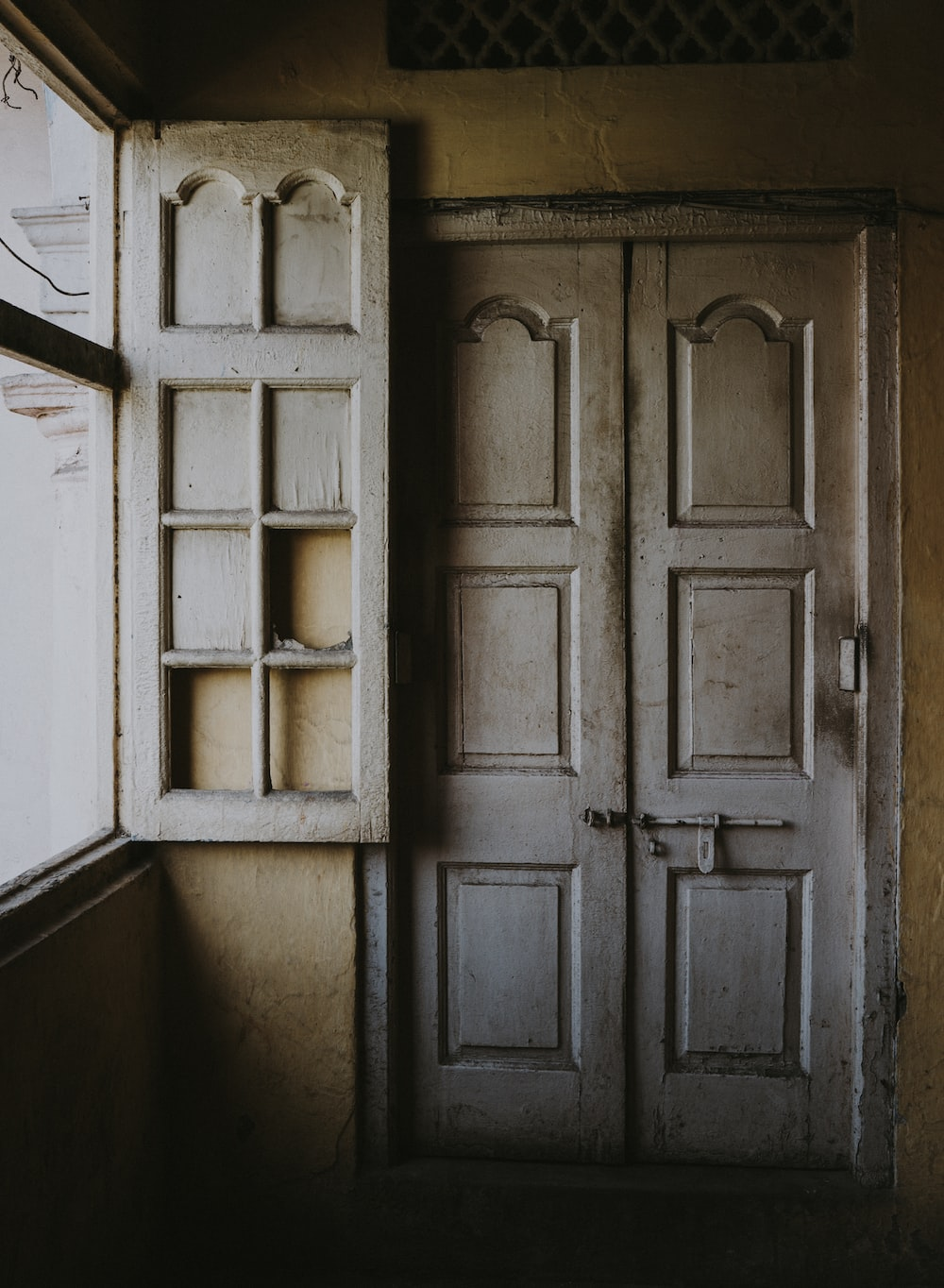 two closed white wooden door