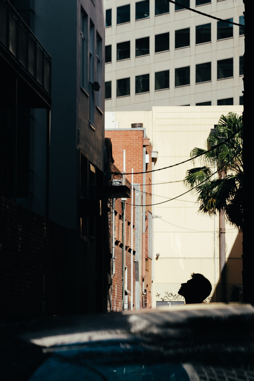 man looking up at building