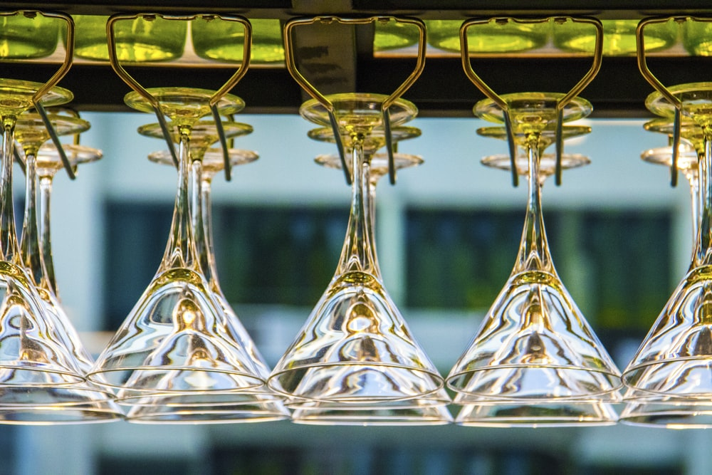 photography of cocktail glass on rack