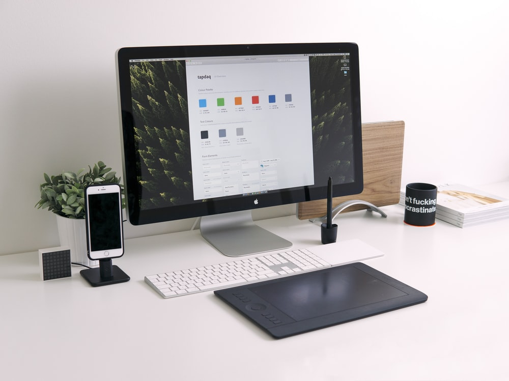closeup photo of Thunder iMac, Keyboard, and trackpad on white desk