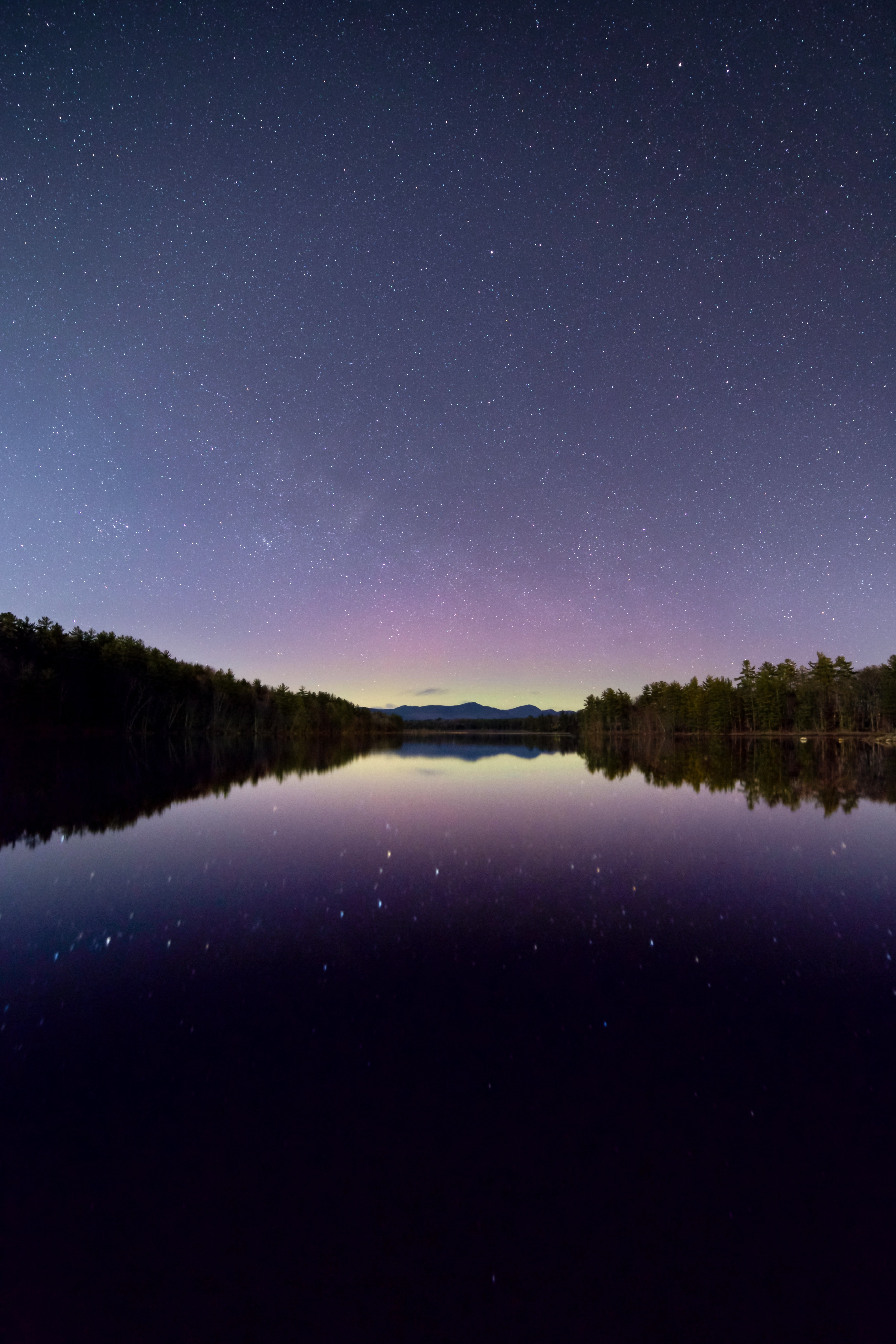 reflection photography of star and sky under calm body of water