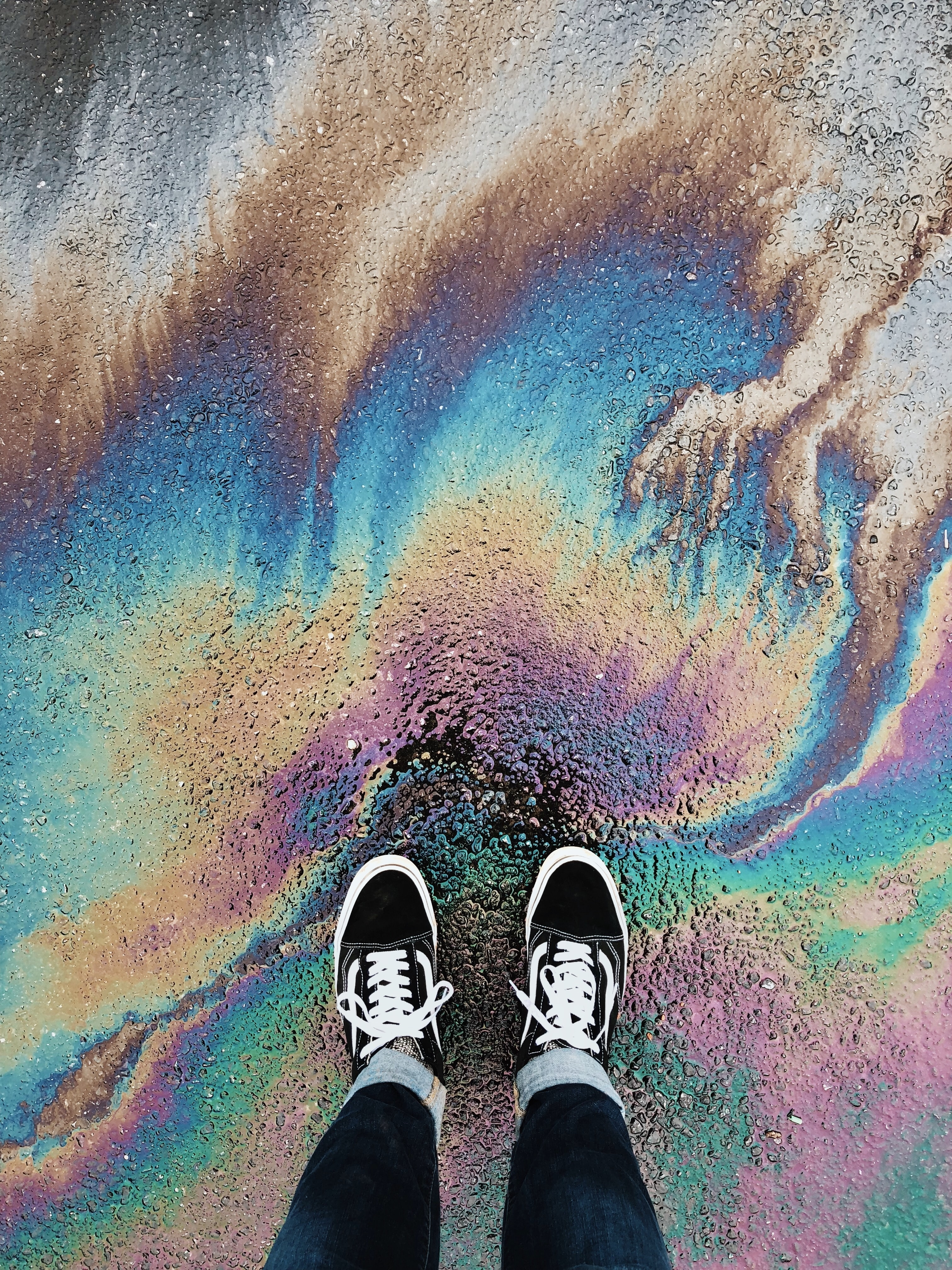 person standing on oil spilled surface