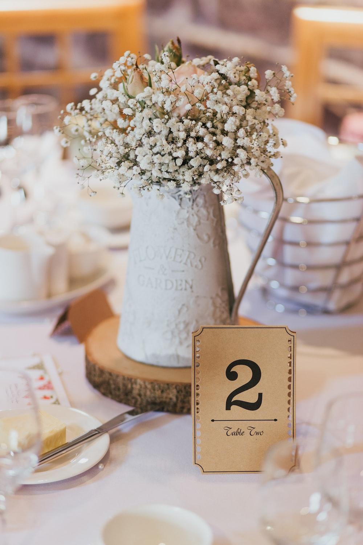 selective focus photo of white petaled flower decors