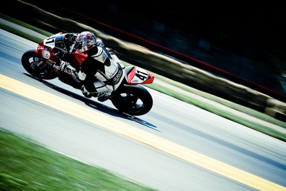 racer riding on sports bike on race track