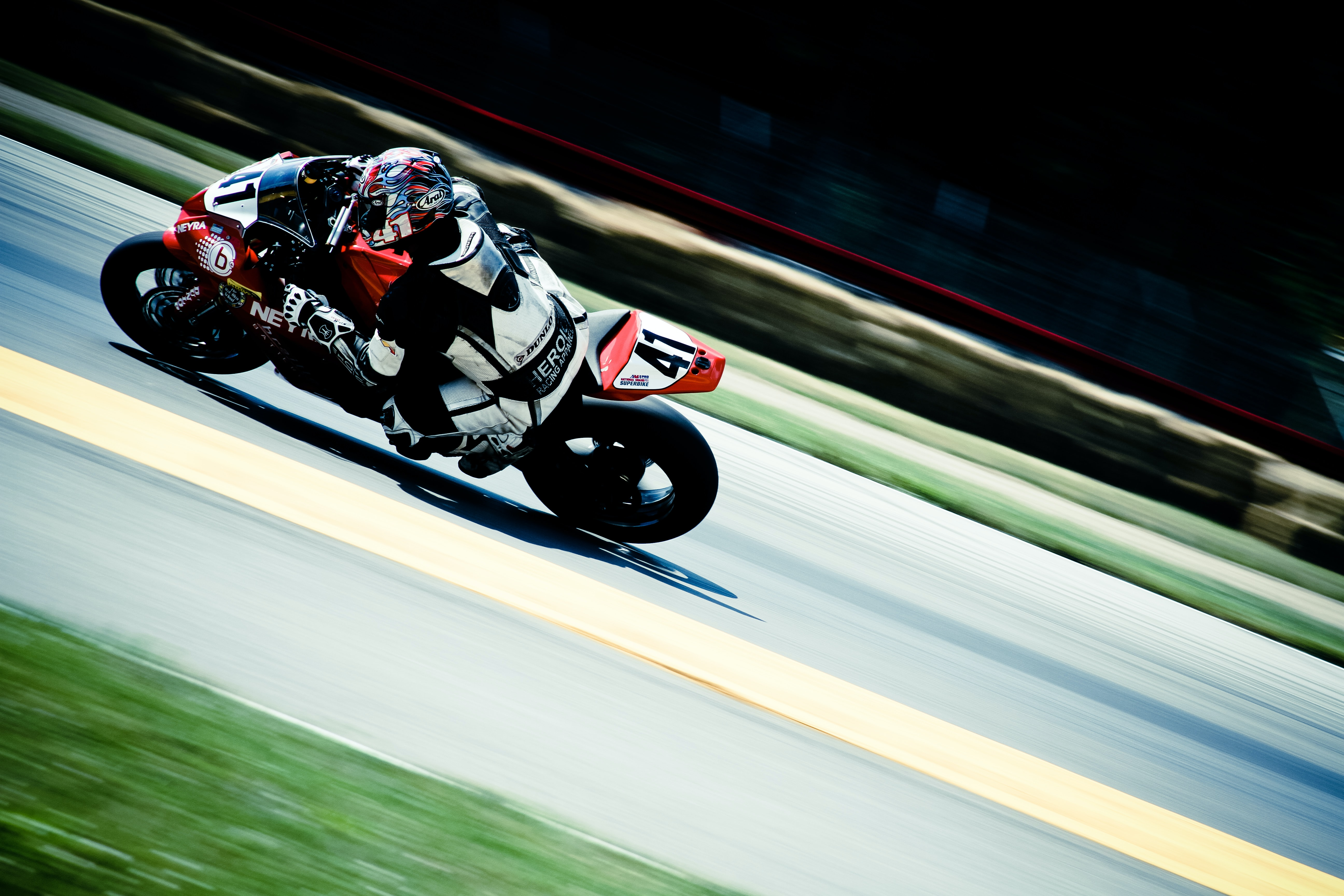 racer riding on sports bike on race track