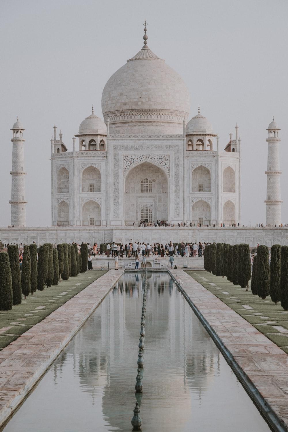 people gathering in Taj Mahal at India during daytime