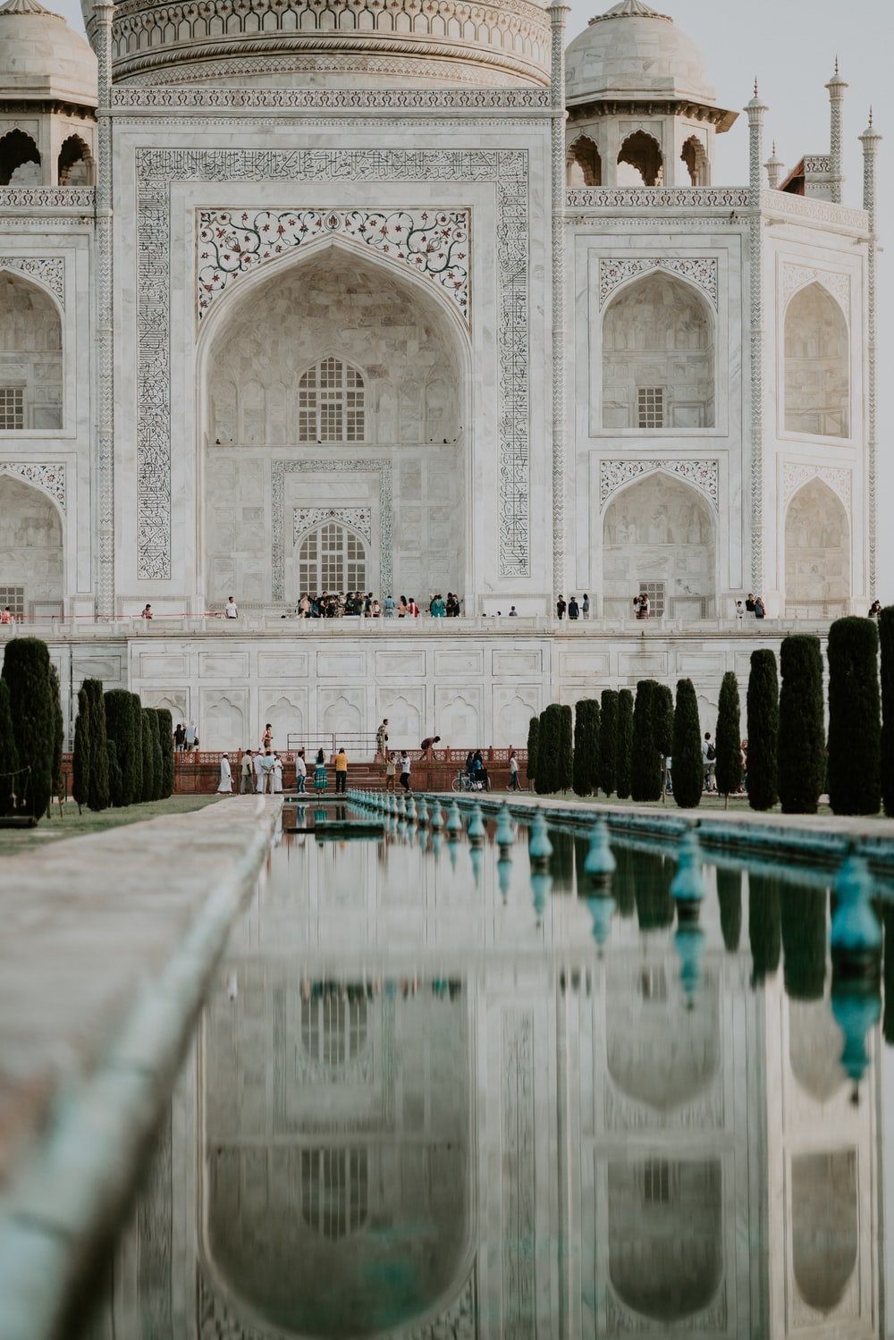 people standing in front of Taj Mahal