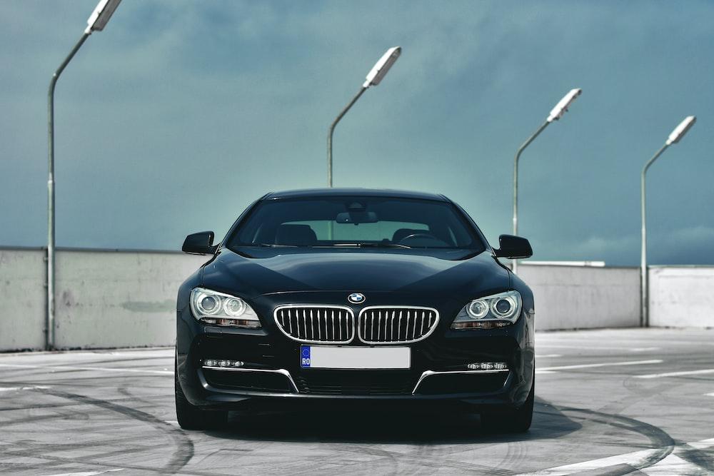 black BMW car parked on road