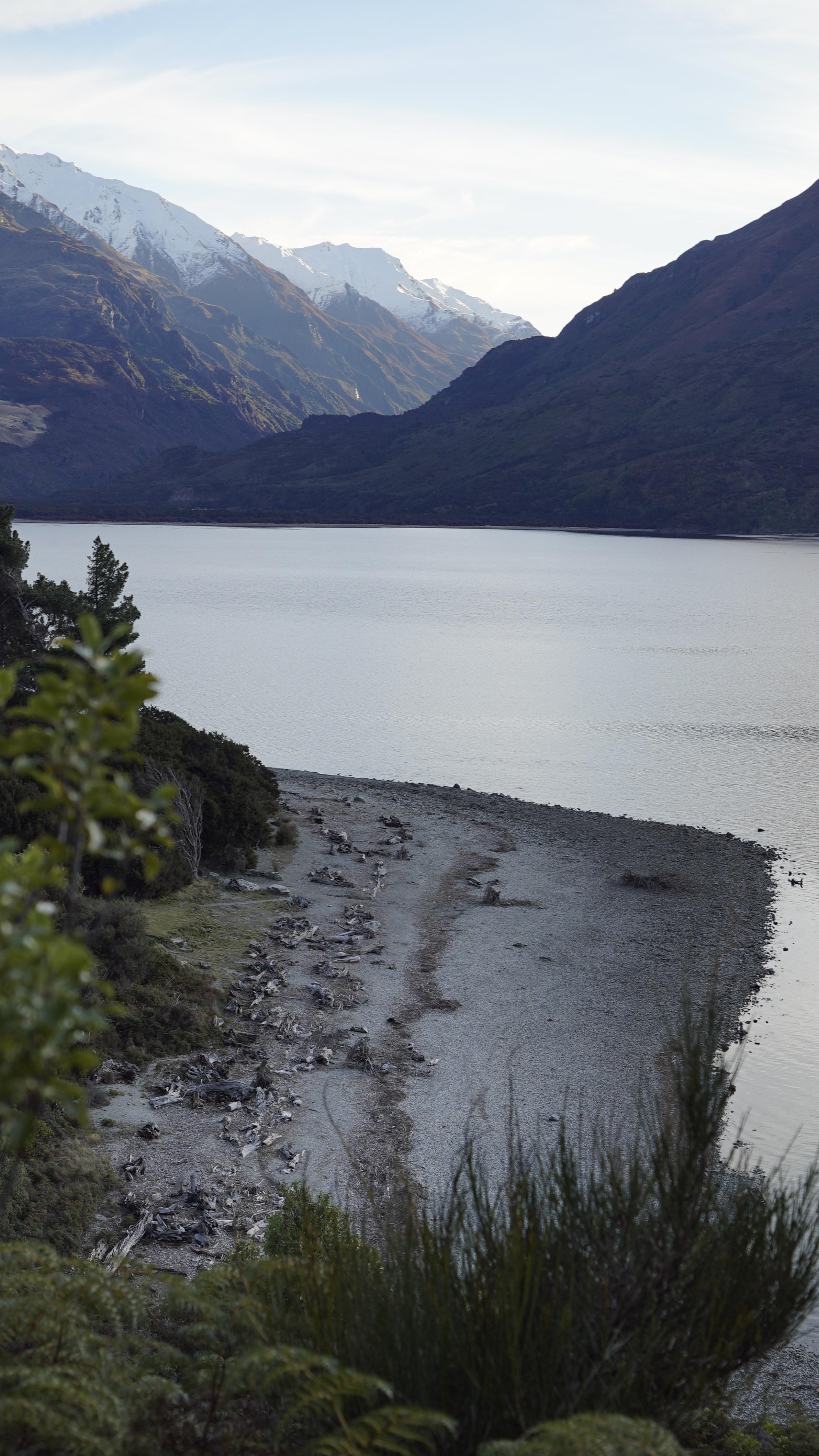 mountain range near body of water